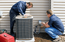 Contractors working on AC unit