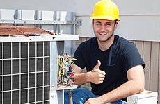 Contractor repairing air conditioner