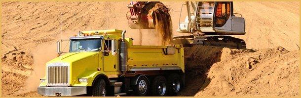Excavator loading a 10-yard dump truck