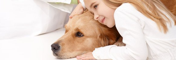 Girl cuddling with dog