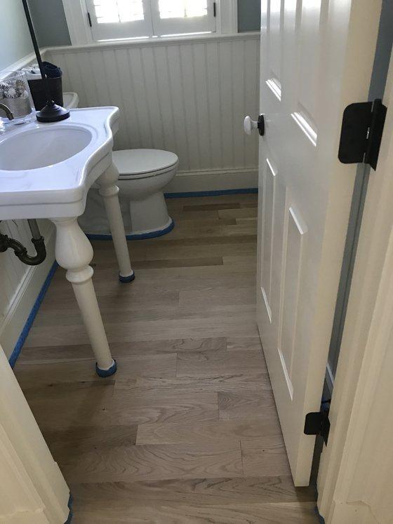 Hardwood floor in bathroom - before