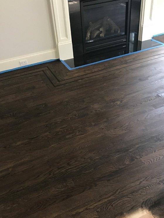 Hardwood floor with trim around fireplace - after
