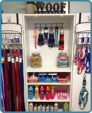 Shelf of pet grooming kits and accesories