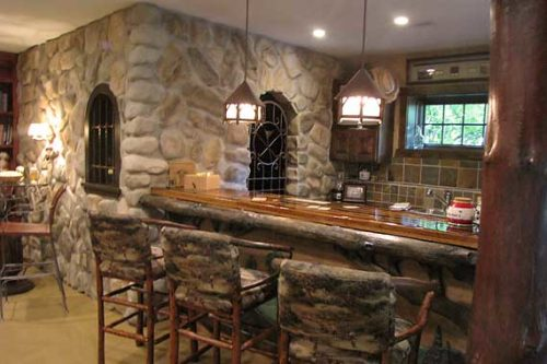 building a custom home_unique stone and wood basement bar