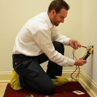 guy checking electric outlet