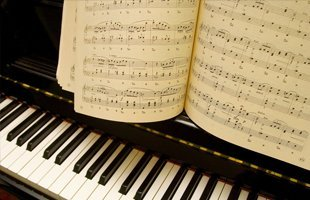 A piano and music sheets