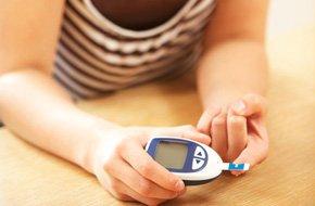Diabetic woman monitoring her blood sugar