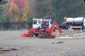 Worker digging dirt