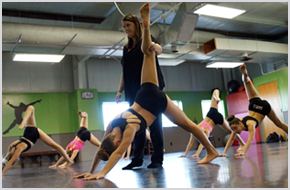 Young girls in a dance studio having practice with their instructor