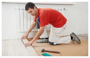 Man applying hardwood floor