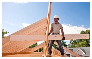 Roofing contractor holding wood