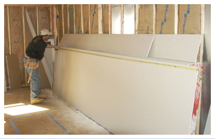 Man installing drywalls