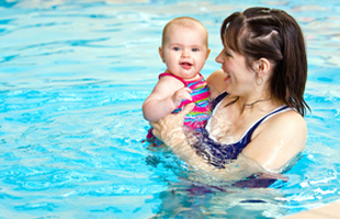 Mother and child having fun on the pool
