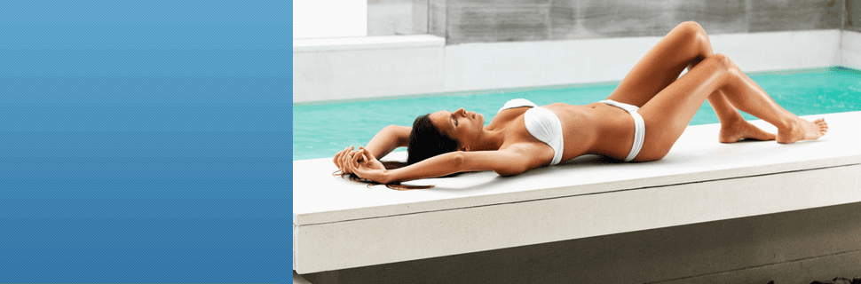 Female relaxing on the pool side