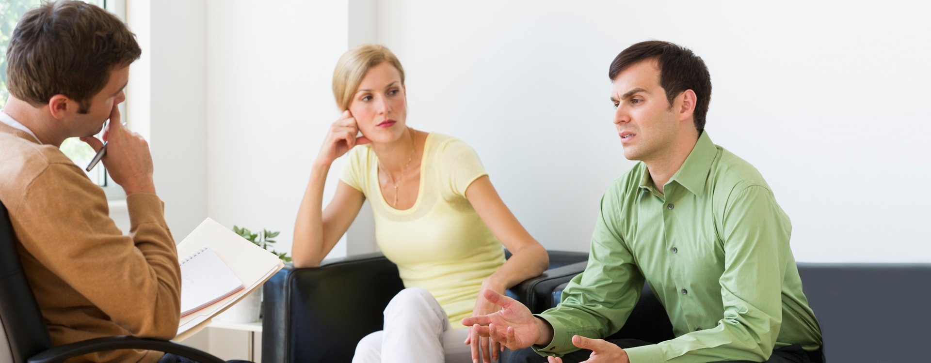 Unhappy couple speaking with attorney