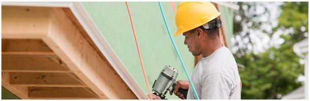Man installing gutter