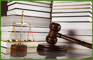 Scale lawbooks and gavel on top of table