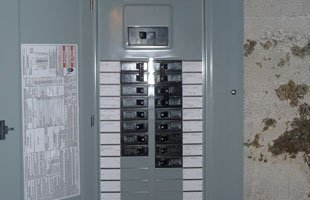 Electrician repairing an eletricl panel
