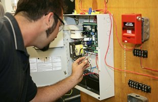 Man working on residential electric panel