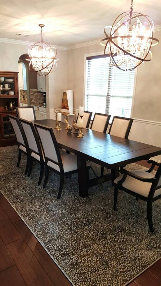 Hardwood flooring and area rug for dining area