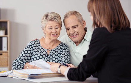 old couple discussing with lawyer
