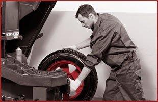Mechanic working on car breaks