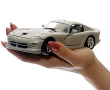 car insurance - West Palm Beach,  FL - J & A Insurance & More Inc. - car in a hand