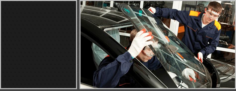 Two mechanics installing a windshield