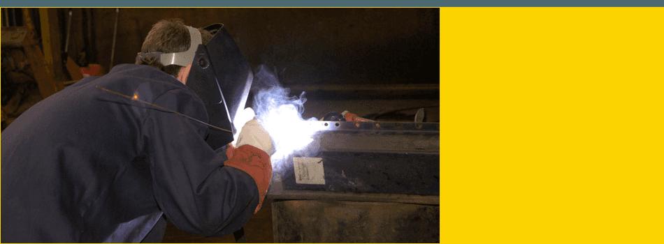 Man welding a piece of metal