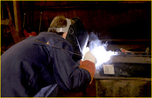 Man welding small piece of metal