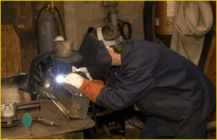 Welder on blue jacket