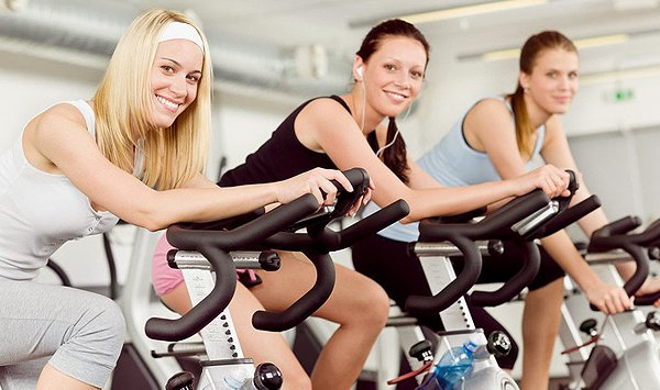 Girls on gym bicycle