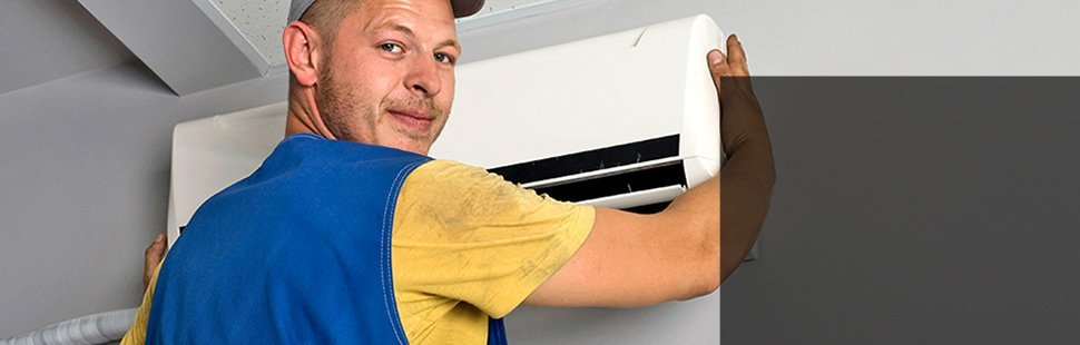 A man installing an air conditioning unit
