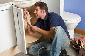 A man repairing a sink