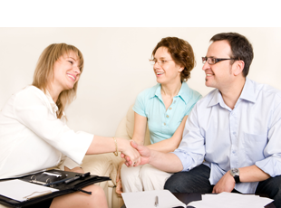 Happy man shaking hand with counselor after counseling