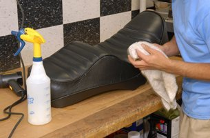 A motorcycle seat being upholstered