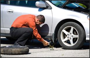 Repairing flat tire in the road