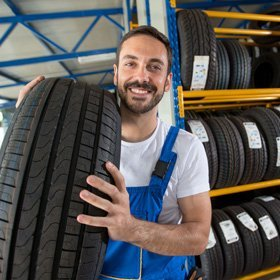 guy holding up tire
