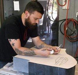 man engraving memorial