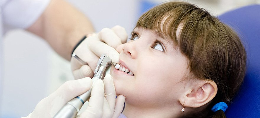 Little girl getting teeth cleaned