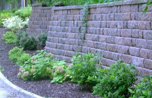 Retaining wall side