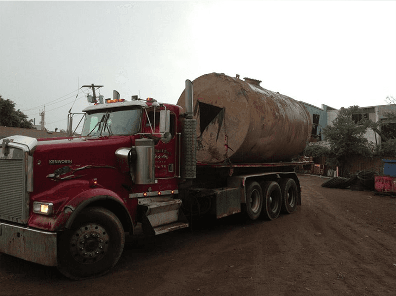 Truck carrying large drum