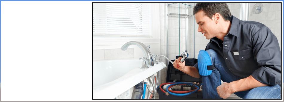 Plumber repairing clogged drain