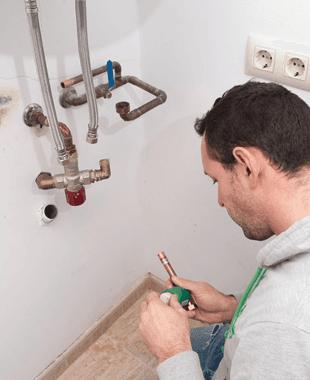 Man installing a heater