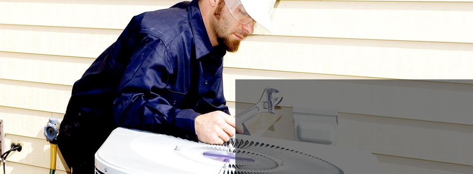 Man repairing air conditioning unit