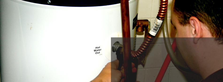 Man reparing water heater