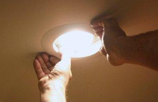 Hands reaching the light bulb