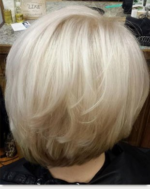 Girl with platinum blonder hair with blue highlights