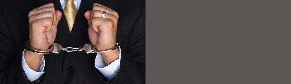 Businessman handcuffed