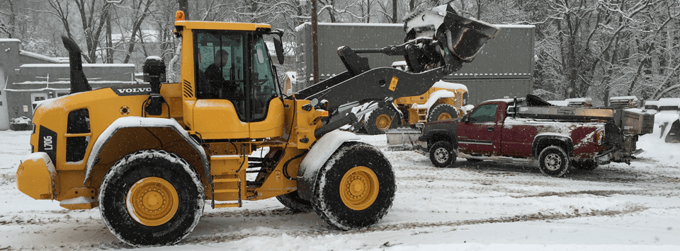 Front end loader and pick-up truck with plow - working in the snow Glen Mills, PA